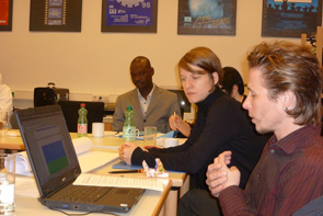 Crosstalk project partners work at a meeting in Vienna